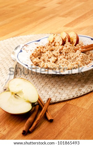 Apple Cinnamon Porridge - shallow depth of field with focus on the bowl