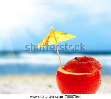 Apple cocktail on a beach - Shutterstock ID 78807064