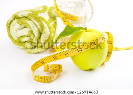 Apple core, towel, bottled water for healthy life - stock photo