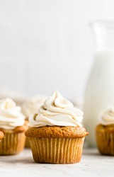 Apple Cupcakes with Maple Buttercream Frosting: soft, fluffy, moist cupcakes filled with tender apples and cozy spices and topped with a creamy maple buttercream frosting.
