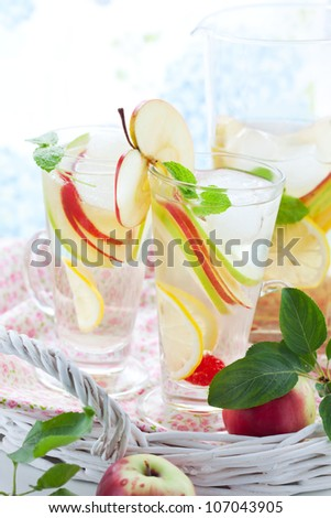 Apple drink with lemon,mint and ice cubes