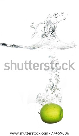 apple fall into water making bubbles