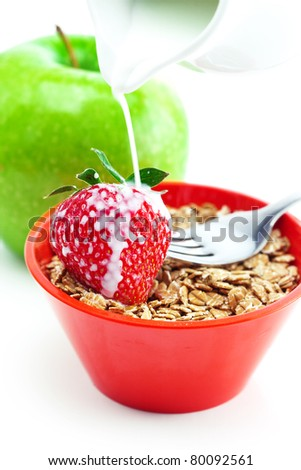 apple, fork, milk and wheat in a bowl isolated on white