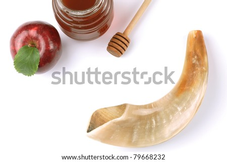 Apple, honey and shofar isolated on white with copy space