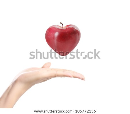 apple in a hand on white background