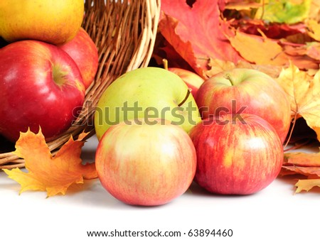 Apple in basket, scattering on white background