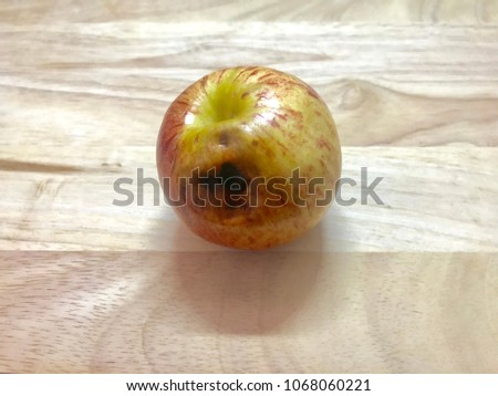 Apple is about to expire on wood background.Can be used as food the ingredients.
