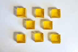 Apple jelly cubes on a white table