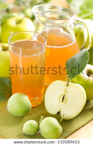 Apple juice and fresh fruits with leaves