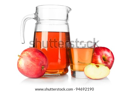 Apple juice. Fresh ripe apples and glass jar of juice isolated on white background