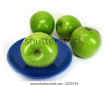 Apple on a dark blue plate on a background of apples, separately on a white background.