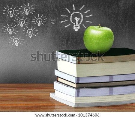 apple on  books - stock photo