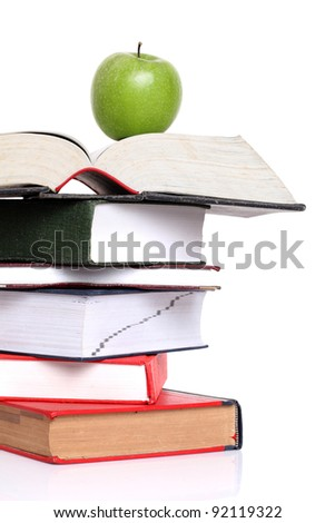 Apple on books. - stock photo