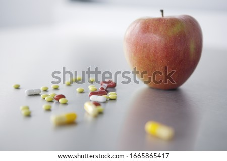 Apple on counter next to medication