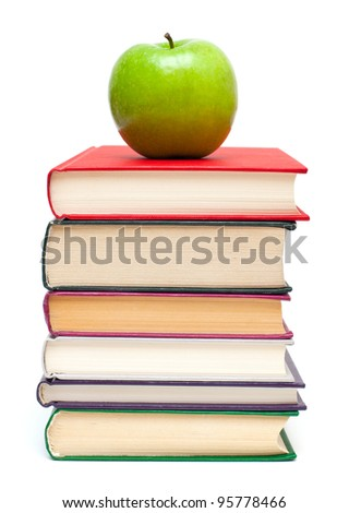 apple on stack of books isolated on white