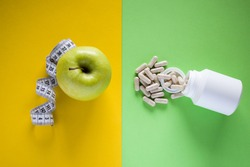 Apple opposite medical pills. Healthy eating opposite medical pills. Healthy dieting, lifestyle