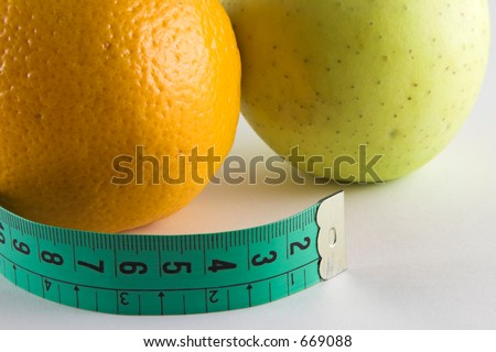 Apple, orange a tape isolated over white background