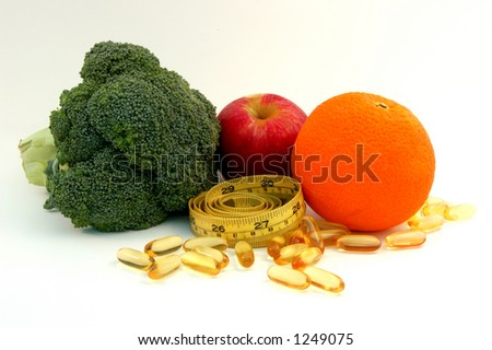 Apple,orange, broccoli,fish oil caplets and measure tape