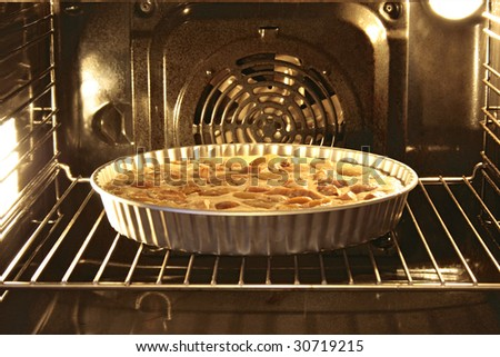 Apple pie in an oven