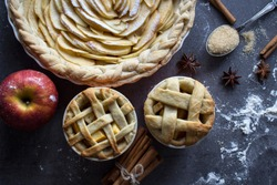 Apple pie top view photo.  Homemade apple pie top view photo.Delicious apple tart or pie on a table. Autumn menu ideas. Healthy eating concept.