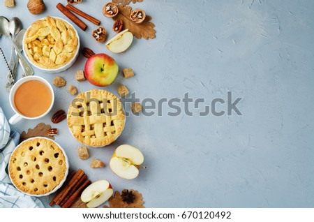 Apple pies with different design on a grey background. toning. selective focus #670120492