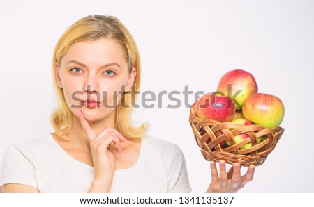 Apple recipes to make this fall. Girl hold basket apples white background. Culinary recipe concept. Woman thoughtful face come up with idea what to cook. Easy culinary ideas. Apple main ingredient.