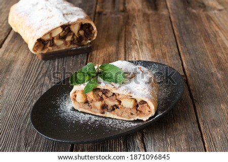 Photo of  Apple strudel is a delicious puff pastry dessert with apples, nuts and raisins. Strudel is a traditional pastry of Austrian, German, Hungarian and Czech cuisine.