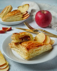 Apple Turnovers are made by filling pastry dough with a sweet or savory filling, sealing the edges and baking. Biting into an apple-filled pastry on the go is a real treat.