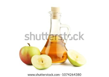 Apple vinegar in glass bottle isolated on white