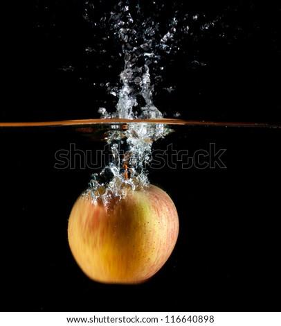 Apple water splash. High speed photography