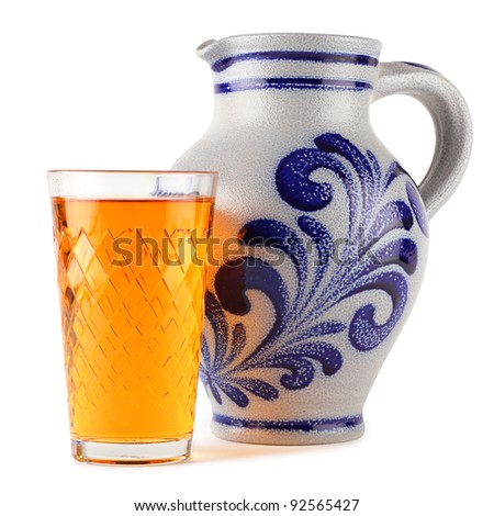 apple wine glass in front of earthenware jug