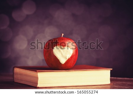 Apple with a heart cut into it. Photo in old color image style