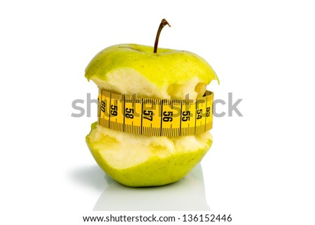 apple with a measuring tape. symbolic photo for diet and healthy, vitamin-rich diet.