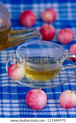 Apple with cup of tea