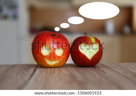 Apple with curved face and curved heart communicate, dialogue bubble #1306001923