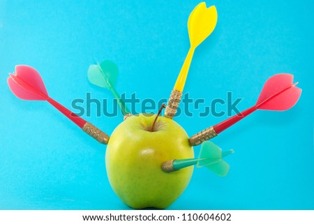 Apple with darts