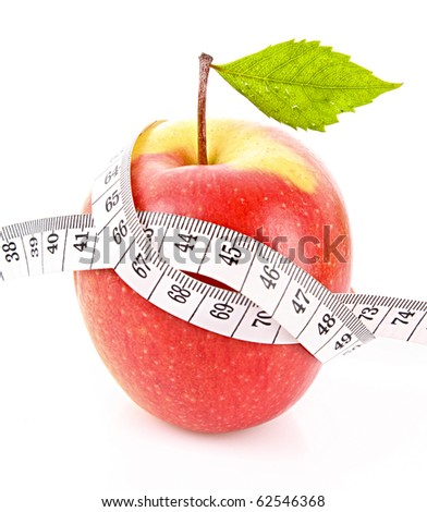 Apple with green leaf and a measure tape, diet concept