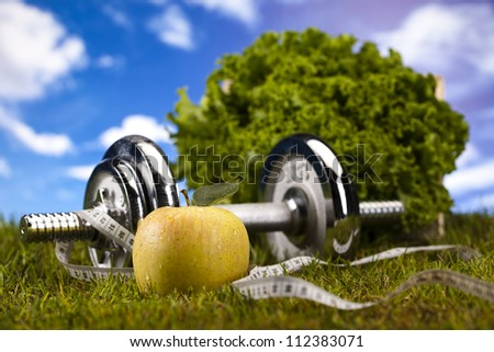 Apple with measuring of dumbbell