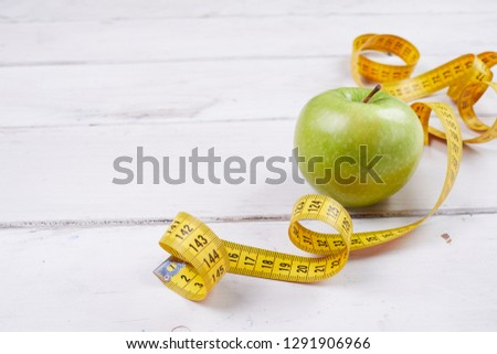 apple with measuring tape #1291906966