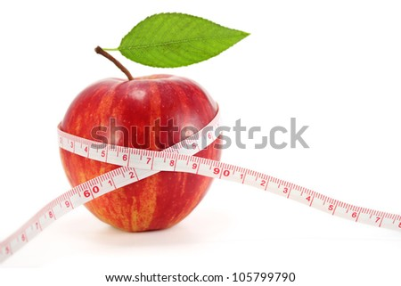 Apple with measuring tape on white