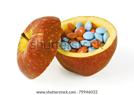 Apple with pills on whine background