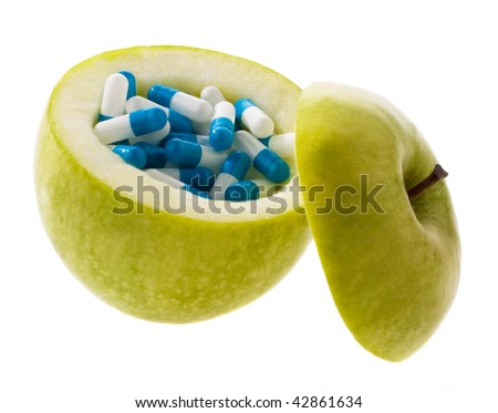Apple with tablets capsules. Representative photo for vitamin tablets