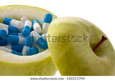 apple with tablets capsules. representative photo of vitamin tablets