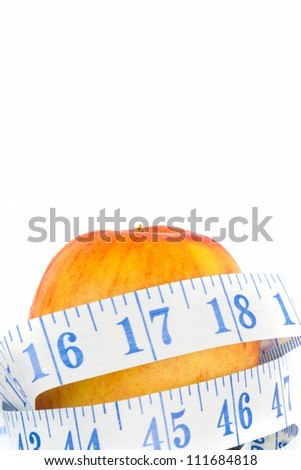 Apple with tape measure isolated on a white background