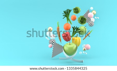 Apple wrapped with the temple line is Surrounded by vegetables on a blue background.-3d rendering.