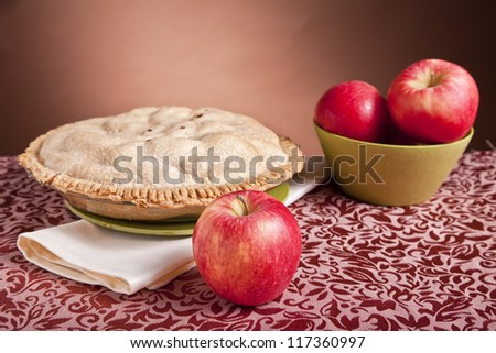 Apples and a freshly baked apple pie.