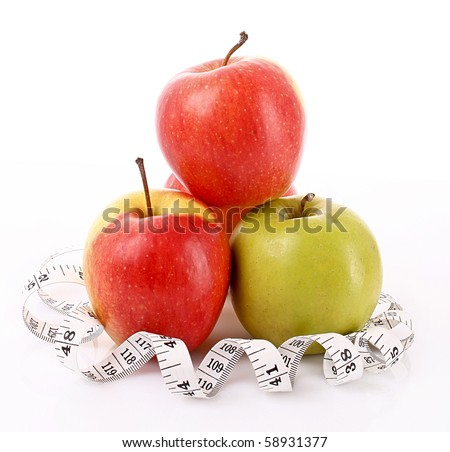 Apples and a measure tape, diet concept
