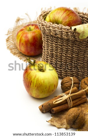 Apples and cinnamon sticks on white background.