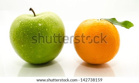 Apples and oranges fresh from the garden isolated white background.