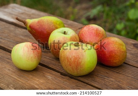 apples and pears on wooden table
